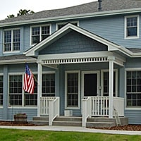 country style home with hardie board siding